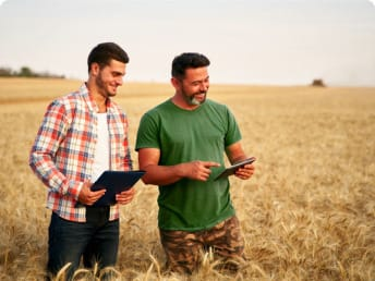 two farmers monitor the state of a crop